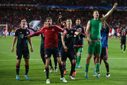 Philipp Lahm, Thomas Mueller, Robert Lewandowski and Manuel Neuer of Bayern Muenchen celebrate victory after the UEFA Champions League quarter final second leg match between SL Benfica and FC Bayern Muenchen at Estadio da Luz on April 13, 2016 in Lisbon, Portugal.