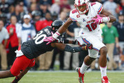 Courtland Sutton #16 of the Southern Methodist Mustangs runs the ball after reception as Chris Murphy #30 of the Cincinnati Bearcats reaches for the tackle at Nippert Stadium on October 21, 2017 in Cincinnati, Ohio.