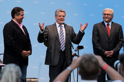German presidential candidate Joachim Gauck (C) speaks at a reception of the German Social Democrats (SPD) as SPD Chairman Sigmar Gabriel (L) and SPD Bundestag faction head Frank-Walter Steinmeier look on on June 29, 2010 in Berlin, Germany. Gauck is the candidate of the SPD and the German Greens Party, and will face candidate Christian Wulff in elections to take place at the Federal Assembly on June 30. Gauck is a pastor and former East German human rights activist.