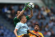 The goalkeeper Alberto Brignoli with his teammates of Benevento Calcio competes for the ball with Lucas leiva of SS Lazio during the Serie A match between SS Lazio and Benevento Calcio at Stadio Olimpico on March 31, 2018 in