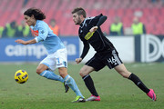 Edinson Cavani of Napoli (L) and Davide Santon of Cesena compete for the ball during the Serie A match between SSC Napoli and AC Cesena at Stadio San Paolo on February 6, 2011 in Naples, Italy.