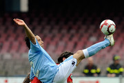 Gianluca Grava of Napoli and Joaquin Larrivey of Cagliari in action during the Serie A match between SSC Napoli and Cagliari Calcio at Stadio San Paolo on April 25, 2010 in Naples, Italy.