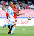 Paolo Cannavaro (L) of Napoli and Joaquin Larrivey of Cagliari in action during the Serie A match between SSC Napoli and Cagliari Calcio at Stadio San Paolo on April 25, 2010 in Naples, Italy.