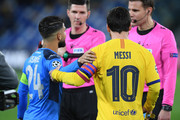 Lorenzo Insigne of SSC Napoli greets Lionel Messi of FC Barcelona before the UEFA Champions League round of 16 first leg match between SSC Napoli and FC Barcelona at Stadio San Paolo on February 25, 2020 in Naples, Italy.