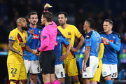 Arturo Vidal (L) of Barcelona is shown a yellow card by referee Mark Borsch of Germany during the UEFA Champions League round of 16 first leg match between SSC Napoli and FC Barcelona at Stadio San Paolo on February 25, 2020 in Naples, Italy.