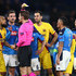 Arturo Vidal Photos - Arturo Vidal (L) of Barcelona is shown a yellow card by referee Mark Borsch of Germany during the UEFA Champions League round of 16 first leg match between SSC Napoli and FC Barcelona at Stadio San Paolo on February 25, 2020 in Naples, Italy. - SSC Napoli v FC Barcelona - UEFA Champions League Round of 16: First Leg