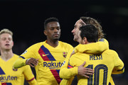 Antoine Griezmann and Lionel Messi of FC Barcelona celebrate the 1-1 goal scored by Antoine Griezmann during the UEFA Champions League round of 16 first leg match between SSC Napoli and FC Barcelona at Stadio San Paolo on February 25, 2020 in Naples, Italy.