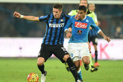 Napoli's player Marques Loureiro Allan vies with FC Internazionale Milano player Stevan Jovetic during the Serie A match between SSC Napoli and FC Internazionale Milano at Stadio San Paolo on November 30, 2015 in Naples, Italy.
