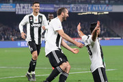 Cristiano Ronaldo, Giorgio Chiellini and Emre Can celebrate the 0-2 goal scored by Emre Can during the Serie A match between SSC Napoli and Juventus at Stadio San Paolo on March 3, 2019 in Naples, Italy.
