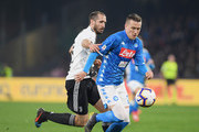 Piotr Zielinski of SSC Napoli vies Giorgio Chiellini of Juventus during the Serie A match between SSC Napoli and Juventus at Stadio San Paolo on March 3, 2019 in Naples, Italy.