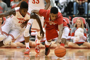 Kam Williams #15 of the Ohio State Buckeyes and Chris Robinson #11 of the Sacred Heart Pioneers battle for control of a loose ball in the second half on November 23, 2014 at Value City Arena in Columbus, Ohio. Ohio State defeated Sacred Heart 106-48.
