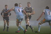 Andy Powell of Sale Sharks attempts to move past Mark Sorenson and Calum Clark of Northampton Saints during the Aviva Premiership match between Sale Sharks and Northampton Saints at Salford City Stadium  on November 30, 2012 in Salford, England.