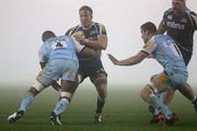 Andy Powell of Sale Sharks attempts to move past Samu Manoa of Northampton Saints during the Aviva Premiership match between Sale Sharks and Northampton Saints at Salford City Stadium  on November 30, 2012 in Salford, England.