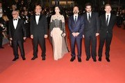 "(FromL) Iranian actor Farid Sajjadihosseini, Iranian actor Babak Karimi, Iranian actress Taraneh Alidoosti, Iranian director Asghar Farhadi, Iranian actor Shahab Hosseini and French producer and distributor Alexandre Mallet-Guy pose as they arrive on May 21, 2016 for the screening of the film ""The Salesman (Forushande)"" at the 69th Cannes Film Festival in Cannes, southern France.  / AFP / ALBERTO PIZZOLI"