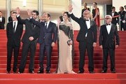 """(FromL) French producer and distributor Alexandre Mallet-Guy, Iranian actor Shahab Hosseini, Iranian director Asghar Farhadi, Iranian actress Taraneh Alidoosti, Iranian actor Babak Karimi and Iranian actor Farid Sajjadihosseini pose as they arrive on May 21, 2016 for the screening of the film """"The Salesman (Forushande)"""" at the 69th Cannes Film Festival in Cannes, southern France.  / AFP / ALBERTO PIZZOLI"""
