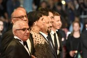 """(FromL) Iranian actor Farid Sajjadihosseini, Iranian actor Babak Karimi, Iranian actress Taraneh Alidoosti, Iranian director Asghar Farhadi, Iranian actor Shahab Hosseini and French producer and distributor Alexandre Mallet-Guy pose as they arrive on May 21, 2016 for the screening of the film """"The Salesman (Forushande)"""" at the 69th Cannes Film Festival in Cannes, southern France.  / AFP / ALBERTO PIZZOLI"""