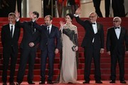 """(FromL) French producer and distributor Alexandre Mallet-Guy, Iranian actor Shahab Hosseini, Iranian director Asghar Farhadi, Iranian actress Taraneh Alidoosti, Iranian actor Babak Karimi and Iranian actor Farid Sajjadihosseini wave as they arrive on May 21, 2016 for the screening of the film """"The Salesman (Forushande)"""" at the 69th Cannes Film Festival in Cannes, southern France.  / AFP / Valery HACHE"""