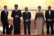 """(FromL) French producer and distributor Alexandre Mallet-Guy, Iranian actor Shahab Hosseini, Iranian director Asghar Farhadi, Iranian actress Taraneh Alidoosti and Iranian actor Babak Karimi  pose as they arrive on May 21, 2016 for the screening of the film """"The Salesman (Forushande)"""" at the 69th Cannes Film Festival in Cannes, southern France.  / AFP / ALBERTO PIZZOLI"""