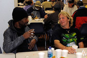 Mike Johnson (L) and James Ritchies enjoy a traditional Thanksgiving meal at the Salvation Army November 26, 2009 in Las Vegas, Nevada. Thanksgiving Day is a holiday celebrated to give thanks for the fall harvest.