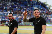 Sonny Bill Williams of the New Zealand All Blacks thanks the crowd with Charlie Ngatai of the All Blacks after winning the International Test match between Samoa and the New Zealand All Blacks at Apia Stadium on July 8, 2015 in Apia, Samoa.