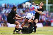 Paul Perez of Manu Samoa charges into Ryan Crotty of the New Zealand All Blacks and Sonny Bill Williams of the New Zealand All Blacks during the International Test match between Samoa and the New Zealand All Blacks at Apia Stadium on July 8, 2015 in Apia, Samoa.