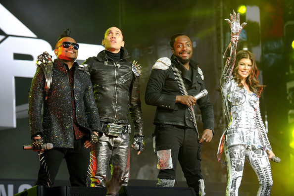 (L-R) Apl.de.Ap, Taboo, Will.i.am and Fergie of the Black Eyed Peas perform at the Samsung Times Square Concert with THE BLACK EYED PEAS at Times Square on March 10, 2010 in New York City.