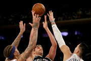 Pau Gasol #16 of the San Antonio Spurs heads for the net as Michael Beasley #8 and Willy Hernangomez #14 of the New York Knicks defend at Madison Square Garden on January 02, 2018 in New York City. NOTE TO USER: User expressly acknowledges and agrees that, by downloading and or using this photograph, User is consenting to the terms and conditions of the Getty Images License Agreement.
