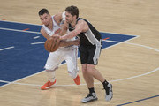 Pau Gasol #16 of the San Antonio Spurs fights for the ball against Willy Hernangomez #14 of the New York Knicks during the game at Madison Square Garden on January 02, 2018 in New York City. NOTE TO USER: User expressly acknowledges and agrees that, by downloading and or using this photograph, User is consenting to the terms and conditions of the Getty Images License Agreement.