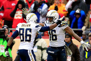 Wide receiver Seyi Ajirotutu #16 of the San Diego Chargers is congratulated by wide receiver Vincent Brown #86 after catching a pass for a touchdown in the final minute of the game against the Kansas City Chiefs at Arrowhead Stadium on November 24, 2013 in Kansas City, Missouri.  The Chargers defeated the Chiefs with a final score of 41-38.