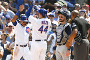 Anthony Rizzo #44 of the Chicago Cubs is greeted by Addison Russell #27 of the Chicago Cubs after hitting a two-run home run against the San Diego Padres during the second inning on August 4, 2018 at Wrigley Field  in Chicago, Illinois.