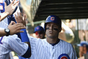 Anthony Rizzo #44 of the Chicago Cubs is greeted in the dugout after hitting a home run against the San Diego Padres during the seventh inning on August 3, 2018 at Wrigley Field  in Chicago, Illinois.