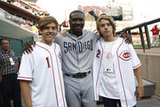 Dylan Sprouse and Cole Sprouse of the hit show the Sweet Life of Zach and Cody pose for a picture with Orlando Hudson #1 of the San Diego Padres before the game between the Cincinnati Reds and the San Diego Padres on August 12, 2011 at Great American Ball Park in Cincinnati, Ohio.