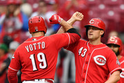Joey Votto #19 of the Cincinnati Reds celebrates at home plate with Scott Schebler #43 of the Cincinnati Reds after Votto hit a three-run home run in the fifth inning against the San Diego Padres at Great American Ball Park on September 9, 2018 in Cincinnati, Ohio.