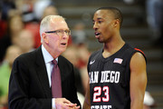 Head coach Steve Fisher of the San Diego State Aztecs talks to D.J. Gay #23 during the team's game against the UNLV Rebels at the Thomas & Mack Center February 12, 2011 in Las Vegas, Nevada. San Diego State won 63-57.