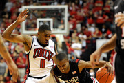 D.J. Gay #23 of the San Diego State Aztecs drives against Oscar Bellfield #0 of the UNLV Rebels during their game at the Thomas & Mack Center February 12, 2011 in Las Vegas, Nevada. San Diego State won 63-57.
