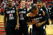 (L-R) Jamaal Franklin #21, James Rahon #11, D.J. Gay #23 and Alec Williams #0 of the San Diego State Aztecs celebrate their 63-57 victory over the UNLV Rebels at the Thomas & Mack Center February 12, 2011 in Las Vegas, Nevada.