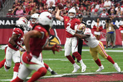 Defensive end Aaron Lynch #59 of the San Francisco 49ers hits quarterback Carson Palmer #3 of the Arizona Cardinals during the first half of the NFL game at the University of Phoenix Stadium on October 1, 2017 in Glendale, Arizona.