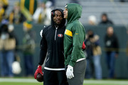 Richard Sherman #25 of the San Francisco 49ers and Jimmy Graham #80 of the Green Bay Packers meet before the game at Lambeau Field on October 15, 2018 in Green Bay, Wisconsin.