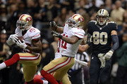 Chris Culliver #29 of the San Francisco 49ers intercepts a pass intended for Jimmy Graham #80 of the New Orleans Saints during the second quarter of a game at the Mercedes-Benz Superdome on November 9, 2014 in New Orleans, Louisiana.