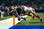 Tavon Austin #11 of the St. Louis Rams scores a touchdown past Ahmad Brooks #55 of the San Francisco 49ers in the second quarter at the Edward Jones Dome on November 1, 2015 in St. Louis, Missouri.