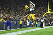 Ty Montgomery #88 of the Green Bay Packers celebrates a touchdown with Jimmy Graham #80 during the first quarter against the San Francisco 49ers at Lambeau Field on October 15, 2018 in Green Bay, Wisconsin.