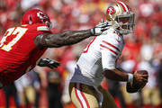 Jimmy Garoppolo #10 of the San Francisco 49ers tried to avoid the sack attempt of Allen Bailey #97 of the Kansas City Chiefs during the fourth quarter of the game at Arrowhead Stadium on September 23rd, 2018 in Kansas City, Missouri.