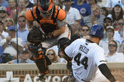 Nick Hundley #5 of the San Francisco Giants forces out Anthony Rizzo #44 of the Chicago Cubs at home plate during the second inning on May 26, 2018 at Wrigley Field in Chicago, Illinois.