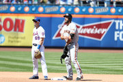 Madison Bumgarner #40 of the San Francisco Giants stands on second base with an RBI double in the fourth inning against the New York Mets during their game at Citi Field on August 23, 2018 in New York City.