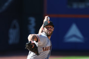 Madison Bumgarner #40 of the San Francisco Giants pitches against the New York Mets during their game at Citi Field on August 23, 2018 in New York City.