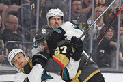 (L-R) Kevin Labanc #62 of the San Jose Sharks, Max Pacioretty #67 of the Vegas Golden Knights and Logan Couture #39 of the Sharks fall to the ice during a fight in the first period of their preseason game at T-Mobile Arena on September 30, 2018 in Las Vegas, Nevada.