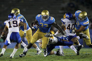 Running back Derrick Coleman #33 of the UCLA Bruins carries the ball against the San Jose State Spartans at the Rose Bowl on September 10, 2011 in Pasadena, California.  UCLA won 27-17.
