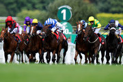 Paul Hanagan riding EtiJaah (C, blue&white) win the British Stallion Studs Supporting British Racing EBF Maiden Stakes at Sandown racecourse on August 31, 2012 in Esher, England.