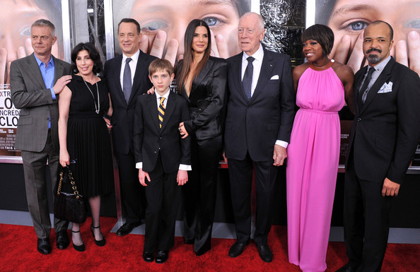 "Sandra Bullock (L-R)  Director Stephen Daldry, President of worldwide marketing for Warner Bros. Sue Kroll, actor Tom Hanks, actor Thomas Horn, actress Sandra Bullock, actor Max Von Sydow, actress Viola Davis, and actor Jeffrey Wright attend the ""Extremely Loud & Incredibly Close"" New York premiere at the Ziegfeld Theater on December 15, 2011 in New York City."