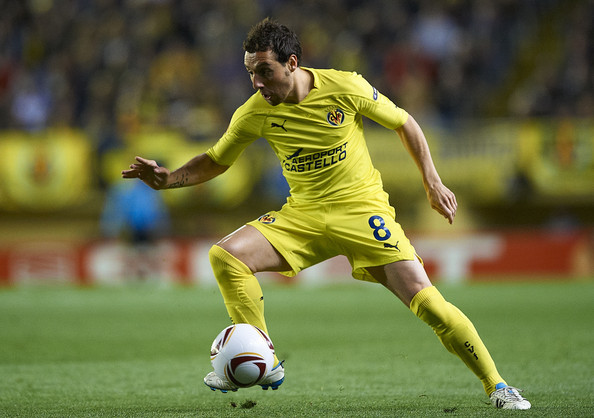 Santi Cazorla Santi Cazorla of Villarreal controls the ball during the UEFA Europa League round of 16 second leg match between Villarreal and Bayer Leverkusen at El Madrigal stadium on March 17, 2011 in Villareal, Spain. Villarreal won 2-1.